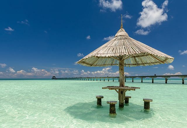 Umbrella in water - Holiday Island, Maldives